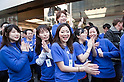 March 16, 2012, Tokyo, Japan - Apple store staff leaves the store to greet the first customers. .Fans lined up overnight outside the Apple store in Ginza, to buy the new iPad. Japan was one of the first countries where Apple fans could get their hands on the new iPad.
