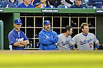 19 September 2012: Los Angeles Dodgers Manager Don Mattingly (left) watches play from the dugout during a game against the Washington Nationals at Nationals Park in Washington, DC. The Nationals defeated the Dodgers 3-1 in the first game of their double-header. Mandatory Credit: Ed Wolfstein Photo