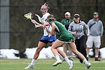 22 February 2015: Duke's Taylor Trimble (in white) and William & Mary's Allison Henry (in green). The Duke University Blue Devils hosted the College of William & Mary Tribe on the West Turf Field at the Duke Athletic Field Complex in Durham, North Carolina in a 2015 NCAA Division I Women's Lacrosse match. Duke won the game 17-7.