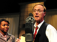 True to life, Norman Gilliland plays a radio announcer in University Theatre's production of War of the Worlds, as Jazzmyne Dickins looks on from the side, on Sunday in Madison