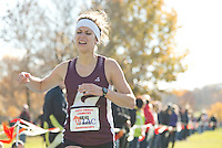 UW-La Crosse's Laura Mead crosses the finish line with a winning time of 21:47 at the WIAC Cross Country Championships meet Saturday, November 2, 2013, at Kilkarney Hills Golf Course. <br /> <br /> Kathy M Helgeson/UWRF Communications