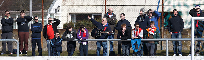 The Stirling Albion guitar man gets the away fans singing at Links Park - or maybe not!