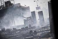 In this Wednesday, Aug. 14, 2013 photo, supporters of the ousted president Mohammed Morsi take cover during clashes with security forces in streets around Al-Raba'a Alawya mosque in the Nasr district of Cairo. (Photo/Narciso Contreras).