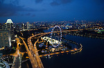 Singapore Flyer ferris wheel from the top of Marina Bay Sands hotel