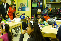 A child raises a flash card.  First and second graders learn Arabic at P.S. 368-Hamilton Heights School in Harlem in New York on Wednesday, May 23, 2012. The program is the first at the K-5 school level in New York City Public Schools.  © Frances M. Roberts)