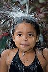 Children enjoying the rain in Los Limites.