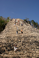 Tourists climbing the Nohoch Mul pyramid at the Mayan ruins of Coba, Quintana Roo, Mexico. This is said to be the tallest Mayan structure on the Yucatan Peninsula..