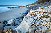 Dusk on beautiful rocky beach with limestone formations at Paturau on west coast of South Island, Nelson Region, New Zealand