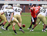 Sept. 3, 2011 - Charlottesville, Virginia - USA; Virginia Cavaliers wide receiver Matt Snyder (14) tries to block the punt of William & Mary Tribe kicker Drake Kuhn (97) during an NCAA football game at Scott Stadium. Virginia won 40-3. (Credit Image: © Andrew Shurtleff