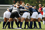 30 August 2009: UNCG's players huddle before the game. The University of North Carolina Tar Heels defeated the University of North Carolina Greensboro Spartans 1-0 at Fetzer Field in Chapel Hill, North Carolina in an NCAA Division I Women's college soccer game.