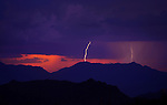 Aug. 21, 2012; Phoenix, AZ, USA: lightning bolt storm monsoon rain cloud sunset thunderstorm  South Mountain Mandatory Credit: Mark J. Rebilas