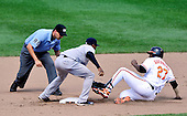 Baltimore Orioles designated hitter Vladimir Guerrero (27) is tagged out by New York Yankee shortstop Eduardo Nunez (26) as he tries to stretch a single into a double in the seventh inning at Oriole Park at Camden Yards in Baltimore, Maryland in the first game of a doubleheader on Sunday, August 28, 2011.  Guerrero had an RBI on the play as Oriole Nick Markakis scored on the play.  The Orioles won the game 2 - 0..Credit: Ron Sachs / CNP.(RESTRICTION: NO New York or New Jersey Newspapers or newspapers within a 75 mile radius of New York City)