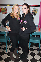 "NO REPRO FEE. 26/5/2011. NEW EDDIE ROCKET'S SHAKE SHOP.  Karin Carthy and Eimear Dennis are pictured in the new Eddie Rocket's Shake Shop. The design seeks to recall the vintage milkshake bars from 1950's America and re-imagine them for the 21st century. The new look aims to appeal to both young and old with a quirky and bold colour scheme and a concept of make-your-own milkshakes, based on the tag line ""You make it...We shake it!"". Eddie Rocket's City Diner in the Stillorgan Shopping Centre in south Dublin has re-opened after an exciting re-vamp and the addition of a Shake Shop. Ten new jobs have been created with the Diner's re-launch bringing the total working in Eddie Rocket's Stillorgan to 30. Picture James Horan/Collins Photos"