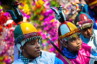 "Salvadoran boys, dressed as Moors and Christians, perform the traditional dance during the Flower & Palm Festival in Panchimalco, El Salvador, 8 May 2011. On the first Sunday of May, the small town of Panchimalco, lying close to San Salvador, celebrates its two patron saints with a spectacular festivity, known as ""Fiesta de las Flores y Palmas"". The origin of this event comes from pre-Columbian Maya culture and used to commemorate the start of the rainy season. Women strip the palm branches and skewer flower blooms on them to create large colorful decoration. In the afternoon procession, lead by a male dance group performing a religious dance-drama inspired by the Spanish Reconquest, large altars adorned with flowers are slowly carried by women, dressed in typical costumes, through the steep streets of the town."