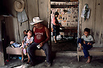 HONDURAS-10006NF, La Fortuna, Honduras, 2004. A family sits together.