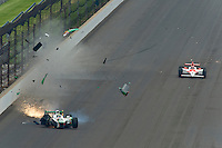 24 May, 2009, Indianapolis, Indiana, USA.Tony Kanaan (#11) crashes on the approach to turn 3..©F. Peirce Williams 2009 USA.ref: Raw Image Capture (.NEF) available