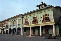 Restored early 20th-century wooden buildings in the Parque Historico, Guayaquil, Ecuador