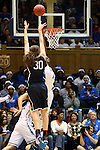 17 December 2013: UConn's Breanna Stewart (30) shoots over Duke's Elizabeth Williams (1). The Duke University Blue Devils played the University of Connecticut Huskies at Cameron Indoor Stadium in Durham, North Carolina in a 2013-14 NCAA Division I Women's Basketball game.