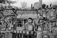 September 1980, West Virginia, USA. Mr Kessinger, who has hung 4,860 various objects in his front yard, in front of his house. | Location: Seth, West Virginia, USA.