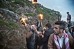 21/03/15 -- Akre, Iraq -- 21/03/15 -- Akre, Iraq -- Young people from the Directorate of Culture in Akre set torches on fire and show them to the crowd, while people around them shoot guns to celebrate.