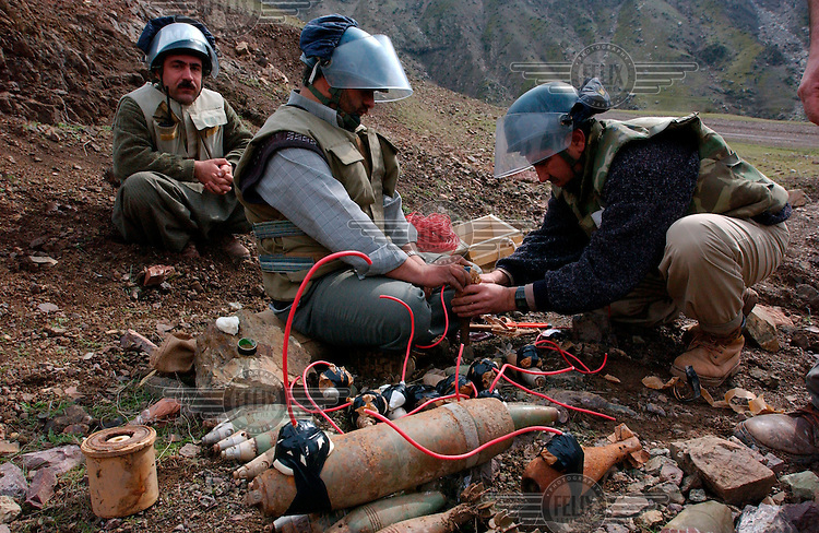 © Sean Sutton / MAG / Panos Pictures..Kurdistan, Iraq. 23/02/2003..Mines Advisory Group (MAG) technicians prepare to destroy unexploded ordnance (UXO) found in a nearby village.