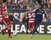 New England Revolution forward Kenny Mansally (7) passes the ball. In a Major League Soccer (MLS) match, the New England Revolution defeated FC Dallas, 2-0, at Gillette Stadium on September 10, 2011.