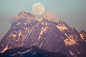 Full moon rising over the Watzespitze (3554m), part of the Glockturmkamm, the westernmost ridge of the Otztal Alps. Nordtirol, Austrian Alps. July.