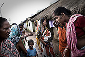 Women gather at the transit camp in Badagabapur, in Jagatsinghpur, Orissa. Posco Transit Camp is being set up for people who have been driven out of their villages for being pro-Posco, where they live on the side of a highway on $80 a day shared between 195 people.