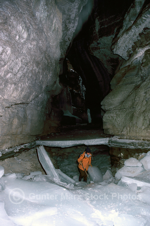 Tourist on an Ice Walk, exploring under the Ice at the River Bottom of Maligne Canyon, in Jasper National Park in the Canadian Rockies, Alberta, Canada