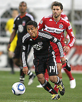 Andy Najar #14 of D.C. United moves away from Peter Lowry #8 of the Chicago Fire during an MLS match on April 17 2010, at RFK Stadium in Washington D.C. Fire won the match 2-0.