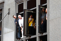 Crowds gather along Grant Street as onlookers peer out of the Koppers Building prior to the start of the Pittsburgh Penguins Stanley Cup victory parade in downtown Pittsburgh, Pennsylvania on June 15, 2016. (Photo by Jared Wickerham / DKPS)