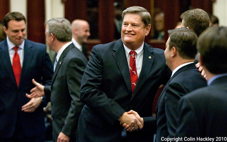TALLAHASSEE, FLA. 3/2/10-OPENING DAY CH64-Agricultural Commissioner Charles Bronson, greets members of the House before the State of the State speech on the opening day of the legislative session, Tuesday at the Capitol in Tallahassee...COLIN HACKLEY PHOTO