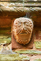 Norman Romanesque exterior corbel no 88 - sculpture of a male with curly hair and theatrical style mouth. The Norman Romanesque Church of St Mary and St David, Kilpeck Herefordshire, England. Built around 1140