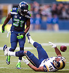 St. Louis Rams tight end Cory Harkey (46) looses the ball after getting hit by Seattle Seahawks strong safety Kam Chancellor (31) at CenturyLink Field in Seattle, Washington on December 28, 2014.  The Seahawks officially wrapped up the No. 1 seed in the NFC playoffs shortly after beating the Rams, 20-6. Despite the Cowboys and Packers also winning to finish 12-4, the Seahawks (12-4) won the multi-team tiebreaker and earned home-field advantage throughout the playoffs for the second consecutive season.  ©2014. Jim Bryant Photo. All Rights Reserved.