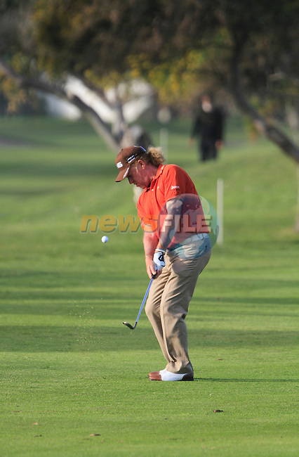 Miguel Angel Jimenez (ESP) chips onto the 18th green during Day 1 Thursday of the Open de Andalucia de Golf at Parador Golf Club Malaga 24th March 2011. (Photo Eoin Clarke/Golffile 2011)