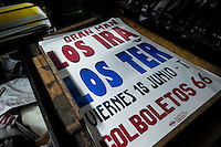 A poster printed on the ancient letterpress machine seen in the print shop in Cali, Colombia, 2 June 2012. Letterpress printing, invented by Johannes Gutenberg in the 15th century, remained the primary way to print and distribute information until the second half of the 20th century. The process of letterpress printing consists of composing movable types into the bed of a press, inking it, and pressing paper against it to create an impression. Nowadays, due to the offset printing expansion, there are few commercial print shops in the world keeping this traditional craftsmanship alive.