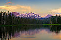 Scott Lake and the Three Sisters (volcanic moutain peaks) at sunset; Cascade Mountains, Oregon.