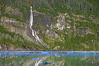 Waterfall flows out of the Chugach National Forest, Prince William Sound, Alaska.
