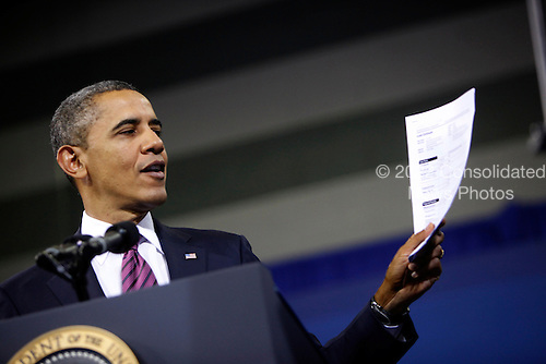 United States President Barack Obama makes a statement on the economy and holds up a new loan application form at James Lee Community Center in Falls Church, Virginia on Wednesday, February 1, 2012..Credit: Dennis Brack / Pool via CNP