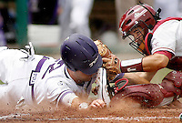 June 19, 2010; Omaha, NE, USA; Florida State Seminoles catcher Rafael Lopez (29) tags TCU Frogs infielder Taylor Featherston (12) out as he attempts to steal home in the fourth inning during game 1 of the 2010 College World Series championships at Rosenblatt Stadium. Mandatory Credit: Crystal LoGiudice-US PRESSWIRE