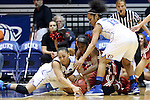 22 March 2014: Oklahoma's Aaryn Ellenberg (center) fights for a loose ball with DePaul's Jessica January (left) and DePaul's Chanise Jenkins (13). The DePaul University Blue Demon played the University of Oklahoma Sooners in an NCAA Division I Women's Basketball Tournament First Round game at Cameron Indoor Stadium in Durham, North Carolina. DePaul won the game 104-100.