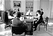 United States President Bill Clinton, far left, and Vice President Al Gore, far right, confer with advisors during an Oval Office meeting on January 29, 1993.  From left to right: President Clinton; Deputy National Security Advisor Sandy Burger; White House Counsel Bernard Nussbaum; Vice President Gore; Communications Director George Stephanopolous; and National Security Advisor Anthony Lake.   Vice President Gore has been actively involved in all of the administration's initiatives..Credit: White House via CNP