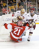 John Muse (BC - 1), Sean Escobedo (BU - 21), Patrick Wey (BC - 6) - The Boston College Eagles defeated the Boston University Terriers 3-2 (OT) in their Beanpot opener on Monday, February 7, 2011, at TD Garden in Boston, Massachusetts.