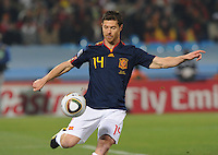 Spanish midfielder Xabi Alonzo clears a ball from danger. Spain won Group H following a 2-1 defeat of Chile in Pretoria's Loftus Versfeld Stadium, Friday, June 25th, at the 2010 FIFA World Cup in South Africa..