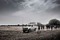 South Sudan. 23 March 2011...Health Workers in the italian NGO &quot;Cuamm - Medici con l'Africa&quot;, installing a mobile clinic for the vaccination of children from a Dinka cattle camp..