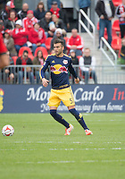Toronto, Ontario - May 17, 2014: New York Red Bulls defender Armando #5 in action during a game between the New York Red Bulls and Toronto FC at BMO Field. Toronto FC won 2-0.
