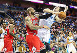 Feb 19, 2013; New Orleans, LA, USA; Chicago Bulls forward Carlos Boozer (5) attempts to knock the ball away from New Orleans Hornets forward Jason Smith (14) during the second half at the New Orleans Arena. Chicago defeated New Orleans 96-87. Mandatory Credit: Crystal LoGiudice-USA TODAY Sports
