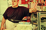 Male street vendor at a market in Little Italy. Manhattan,  New York City