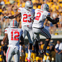 Ohio State Buckeyes safety Christian Bryant (2) celebrates his interception against California Golden Bears with teammate Ohio State Buckeyes defensive back Tyvis Powell (23) in the 1st quarter at Memorial Stadium in Berkeley, California on September 14, 2013.  (Dispatch photo by Kyle Robertson)