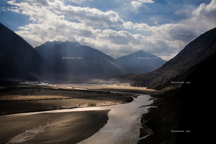Sunbeams shine down on the Shyok river in Hundar, Nubra Valley, Ladakh on 5th June 2009. Ladakh is located in the Himalayas, in the state of Jammu and Kashmir, India.  Photo by Suzanne Lee